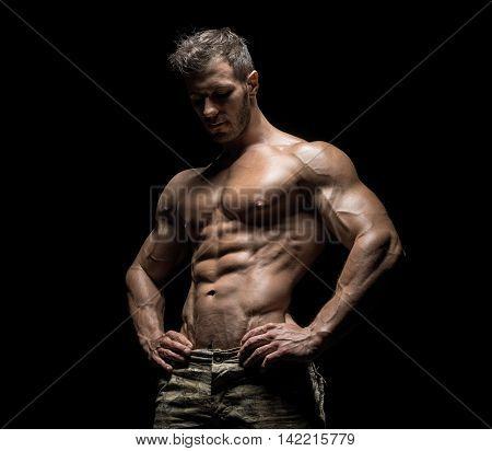 Muscular Athlete Bodybuilder Man On A Dark Background