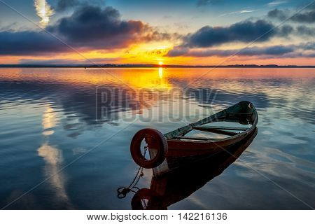 Sunrise on Lake Seliger with an old boat in the foreground Tver region Russia.