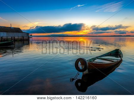 Sunrise on Lake Seliger with an old boat in the foreground Ostashkov Tver region Russia.