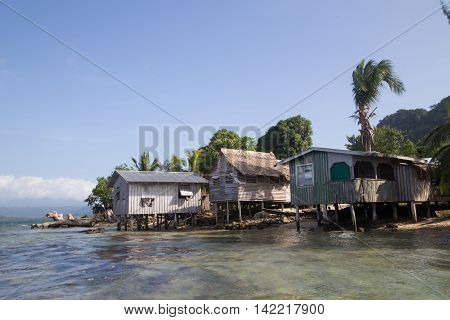 Chea Village, Solomon Islands - May 31, 2015: Houses along the coastline in a village on the Solomon Islands