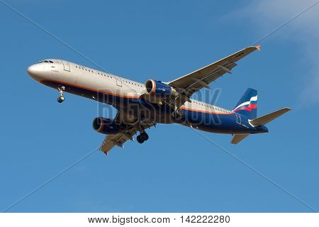 ST. PETERSBURG RUSSIA - MARCH 20 2016: Russian airline Aeroflot Aircraft Airbus A321 (VP-BWN) flying in the blue sky