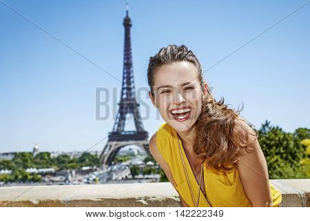 Smiling Young Woman In Bright Blouse Against Eiffel Tower, Paris