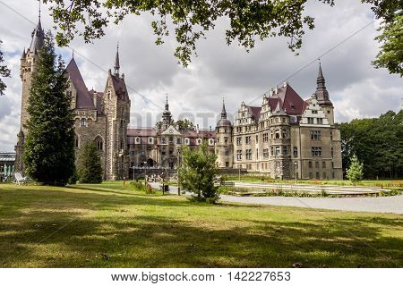 MOSZNA POLAND - AUGUST 7: The Moszna Castle (Polish: Pałac w Mosznej) is a historic castle and residence located in a small village on august 7 2016 in Moszna. The castle is one of the best known monuments in the western part of Upper Silesia.