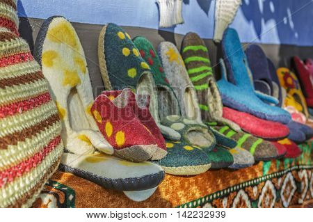 Colorful handmade wool and felt slippers exhibited at a traditional fair in Transylvanian village of Viscri Romania.
