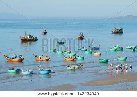 MUI NE, VIETNAM - DECEMBER 25, 2015: Early morning in the Fishing harbor village of Muy Ne.Tourist landmark of the  Vietnam