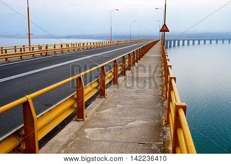 Yellow Guard Rails Alongside the Pedestrian Lane of a Beam Bridge