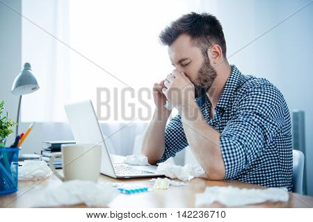 Portrait Of Ill Businessman With Fever And Running Nose