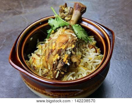 A bowl of Chicken Biryani an Indian rice meal with spicy Chicken marinated in yogurt.