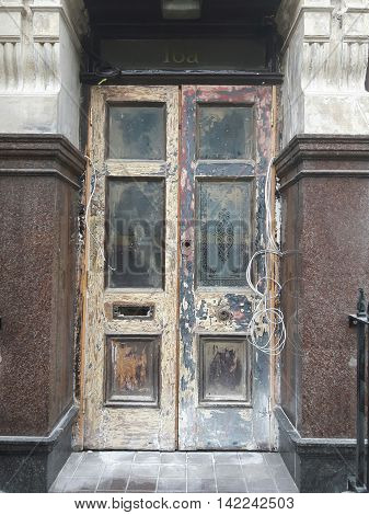 Old building door and entrance under refurbishment, London England