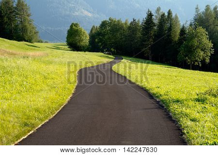 Curved road in the countryside. Mountain place.