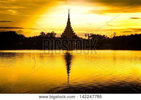 Thailand Bhudda temple golden Stupa Khonkaen landmark,Temple Silhouette in Khon Kaen, Thailand; Wat Nong Waeng (Temple),