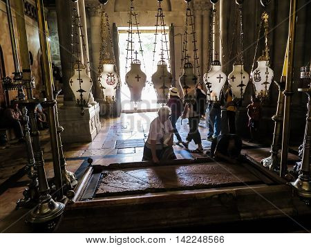 Jerusalem Israel - July 15 2015: Stone of the Anointing of Jesus in the Holy Sepulchre the holiest place of Christians Jerusalem Israel
