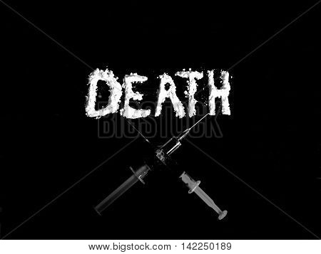 Cocaine drug powder in shaped death word and two crossed injections on black background in black and white colors poster