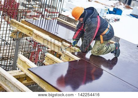 Carpenter worker preparing construction formwork