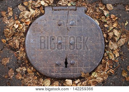hinged cover sewer manhole. old design manhole covers, top view