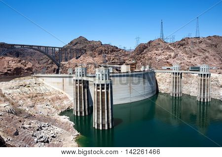 Tourists walk along Hoover Dam located on the borders of Nevada and Arizona as generates electricity from the flow of the Colorado River USA.