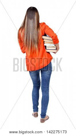 Girl comes with  stack of books. back side view. Rear view people collection.  backside view of person.  Isolated over white background. student in red jacket goes back frame difficult holding a stack