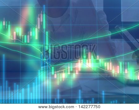 Double exposure of stocks market chart and stock data in blue on LED display with business man and women using laptop computer and smart phone group working together background.