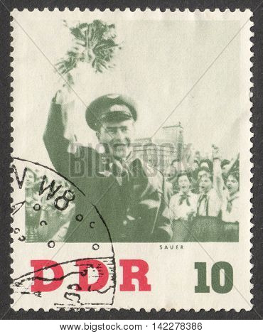MOSCOW RUSSIA - CIRCA MAY 2016: a post stamp printed in DDR shows a portrait of the Soviet Cosmonaut Gherman Titov the series