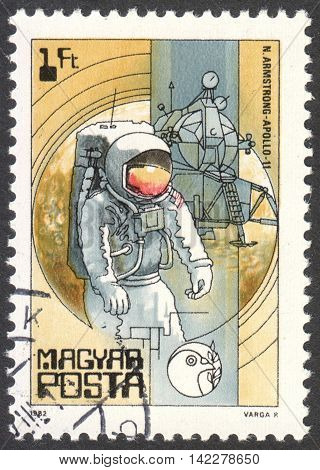 MOSCOW RUSSIA - CIRCA MAY 2016: a post stamp printed in HUNGARY shows Neil Armstrong and Apollo 11 the series