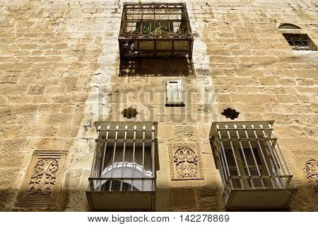 House facade with khachkar ornaments in Armenian Quarter of Old City Jerusalem.