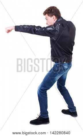 back view of guy funny fights waving his arms and legs. Isolated over white background. Rear view people collection.  backside view of person. Curly guy in a black leather jacket stretched out his