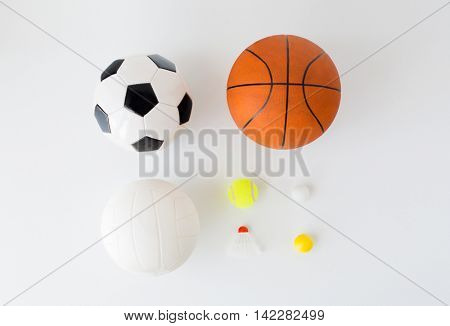 sport, fitness, game, sports equipment and objects concept - close up of different sports balls set and shuttlecock over white background from top