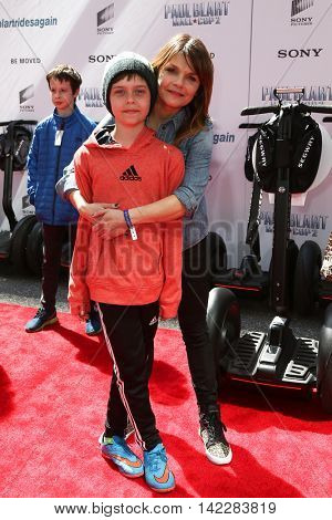 NEW YORK-APR 11: Actress Kathryn Erbe and son Carson attend the world premiere of