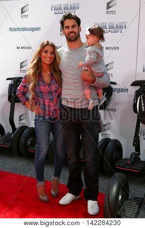 NEW YORK-APR 11: (L-R) Jessie James Decker, NFL player Eric Decker and Vivianne Decker attend the premiere of