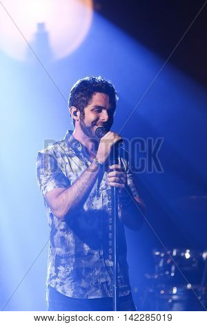 NEW YORK-SEPT 28: Country music artist Thomas Rhett performs at the iHeartRadio Album Release Party with Thomas Rhett on September 28, 2015 at the iHeartRadio Theater in New York City.