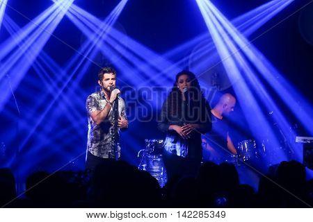 NEW YORK-SEPT 28: Singer Thomas Rhett (L) and Jordin Sparks perform at the iHeartRadio Album Release Party with Thomas Rhett on September 28, 2015 at the iHeartRadio Theater in New York City.