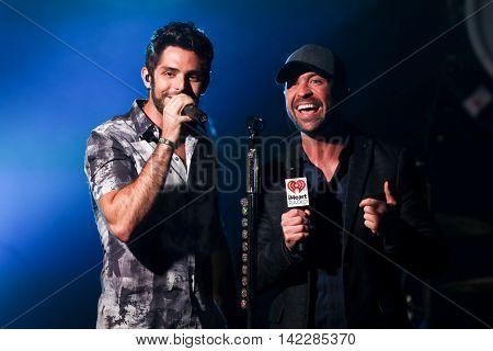 NEW YORK-SEPT 28: Singer Thomas Rhett (L) and radio host Cody Alan at the iHeartRadio Album Release Party with Thomas Rhett on September 28, 2015 at the iHeartRadio Theater in New York City.