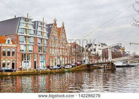 Haarlem, Netherlands - April 2, 2016: Picturesque landscape with beautiful traditional houses in Haarlem, Holland