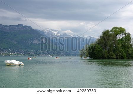 ANNECY FRANCE - 29 APRIL 2015: View on the lake of Annecy capital of Haute Savoie province in France. Annecy is known to be called the French Venice
