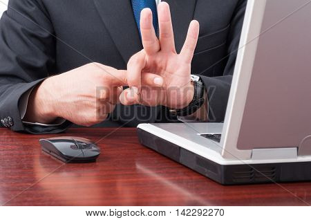 Closeup Of Businessman Hand Simulating Sex