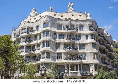 BARCELONA SPAIN - JULY 5 2016: Casa Mila better known as La Pedrera. This famous building was designed by Antoni Gaudi included in the list of UNESCO.
