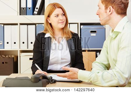 Tax consultant giving financial advice to a man in an office