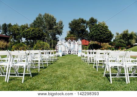 Rows Of White Folding Chairs On Lawn