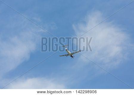 A Single Prop Plane from Below on sky
