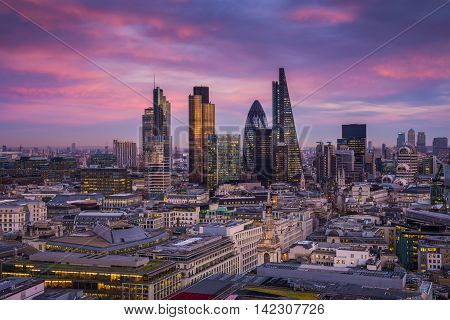 Bank district of central London at magic hour after sunset with office buildings and beautiful purple sky - England, UK