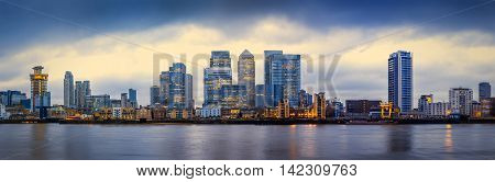 Panoramic skyline of Canary Wharf, the worlds leading financial district at blue hour - London, UK