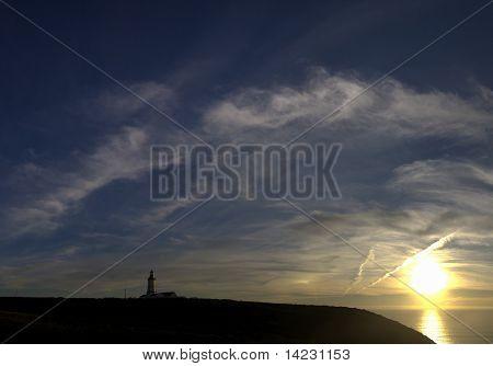 Silhouette Sunset At Cape Espichel.