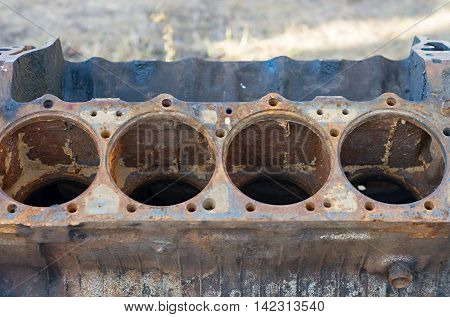 Four old rusty cylinder internal combustion engine