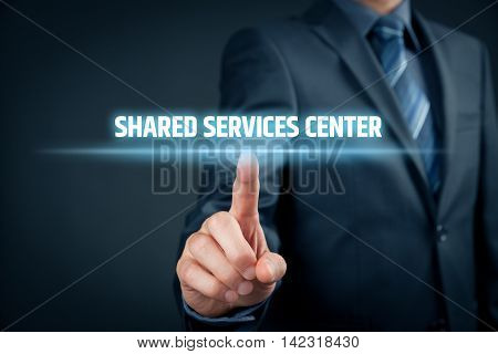 Shared services center (SSC) concept. Businessman click on text Shared Services Center.