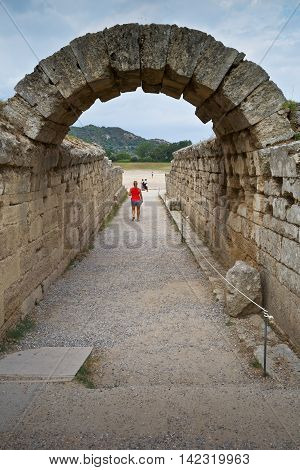 Arched way to the stadium in the archaeological site of Ancient Olympia.