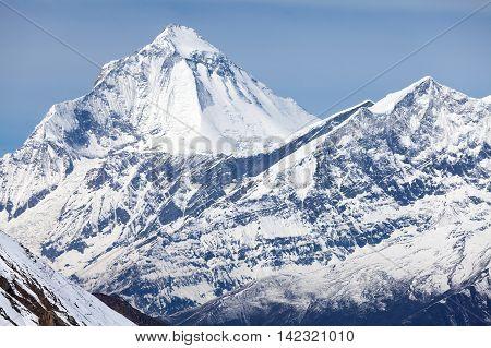 Summit of mount Dhaulagiri from Thorong La Pass on Round Annapurna trek Annapurna Circuit Mustang Nepal