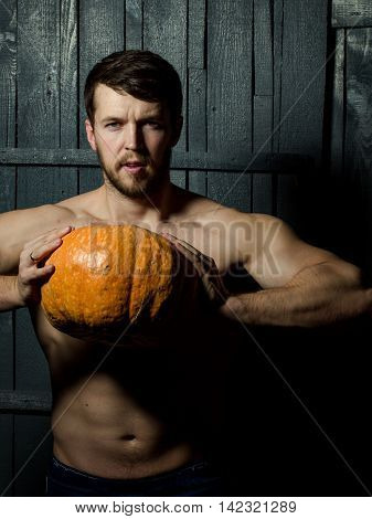 Muscular Guy With Pumpkin