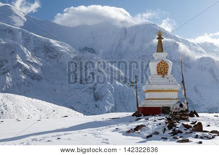 Stupa at Kicho Tal with Annapurna peaks on background Annapurna Circuit Manang Nepal. poster