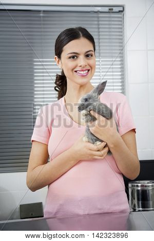 Beautiful Mid Adult Woman Holding Ill Rabbit