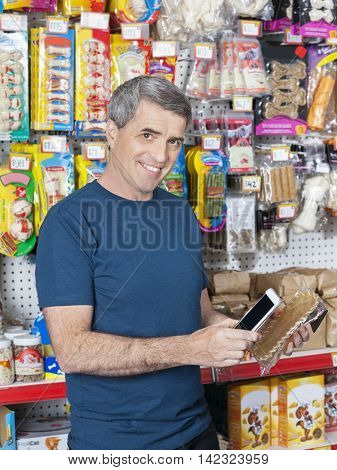 Confident Male Customer Scanning Pet Product